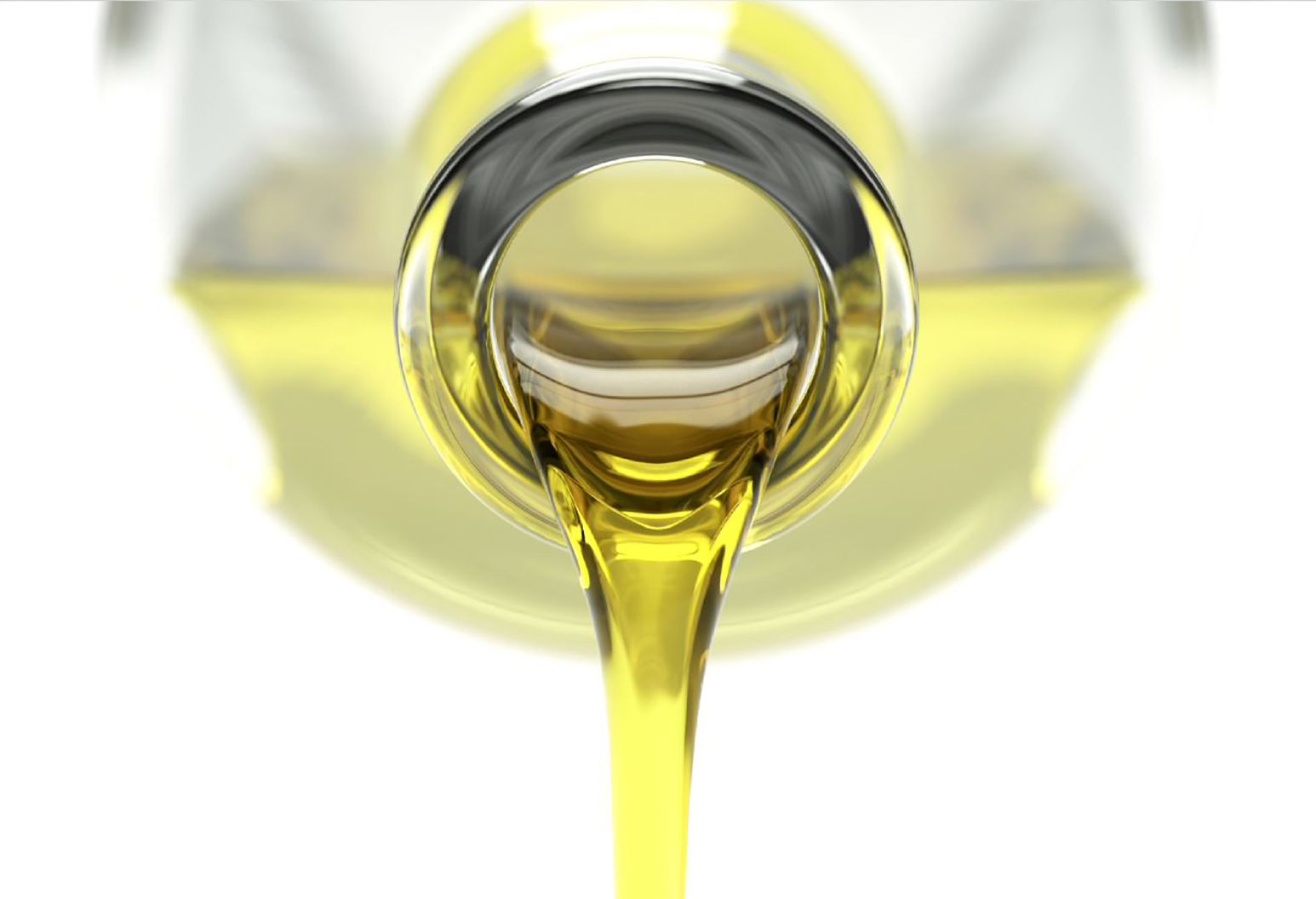 Close up of olive oil pouring out of a bottle