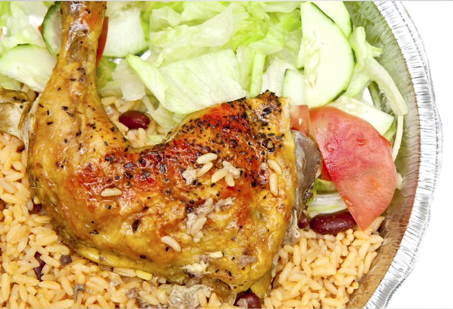 Close up photograph of a plate of chicken, rice, and salad